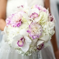 The florist combined soft white hydrangeas with more structured dahlias and orchids for a romantic look. From A Modern Wedding in Chicago, IL