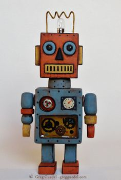 Hand carved vintage inspired robot by greg guedel