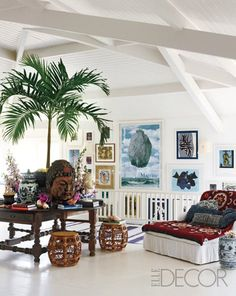 Ceilings, palm tree, desk in the middle of the room, big red comfy chair - put all those things in my office to be please!