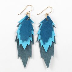 Don't love this shape, but like the layered idea. leather earrings