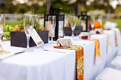 Outdoor Reception Tables, white linen with Pattern Napkins.  Jam Jars & Lantern Center Pieces by Figlewicz Photography