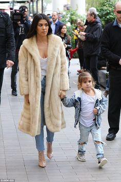 Got them beat: Four-year-old Penelope looked even more stylish than her mom or aunt in jeans and a fur-lined denim jacket