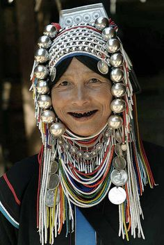 Thailand Hill Tribes   Portrait of an Akha woman wearing traditionally adorned, including the blackened teeth   © Steve Evans  { In Thailand woman used to blacken their teeth with betelnut and/or tobacco, more recently women have used black enamel.}