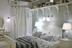 esp the curtain situation and above the bed shelving    ikea
