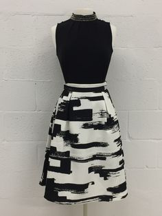 A white and black abstract pattern woven skirt feels artsy yet professional. #Yuppie