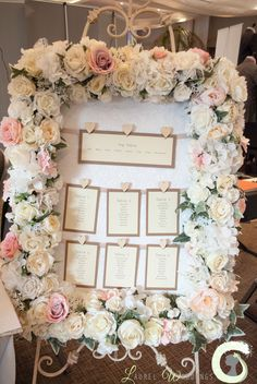 Pink and white silk flower table plan frame - Laurel Weddings spring wedding fayre at @themereresort - http://www.laurelweddings.com/arrangements-from-the-mere-wedding-fayre/