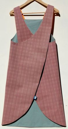 Reversible Japanese crossover back apron in waterproof canvas with orange and blue lining