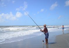 Fishing in the beautiful Atlantic Ocean surf in Myrtle Beach, South Carolina - now that's fishing!  http://www.visitmyrtlebeach.com/things-to-do/fishing/