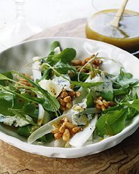 Arugula-Endive Salad with Honeyed Pine Nuts: This salad reinvents the classic combination of blue cheese and honey with crumbled Maytag blue and a crunchy, brittle-like garnish made from honey and pine nuts. Pine nuts have a subtle flavor that goes especially well with milder honeys, but other nuts, like pecans and walnuts, work nicely here, too.
