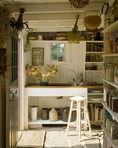 This sunny entry in a Connecticut colonial also serves as a potting area and pantry. Photo: Brian Vanden Brink.