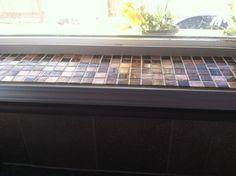 Tile windowsills in kitchen