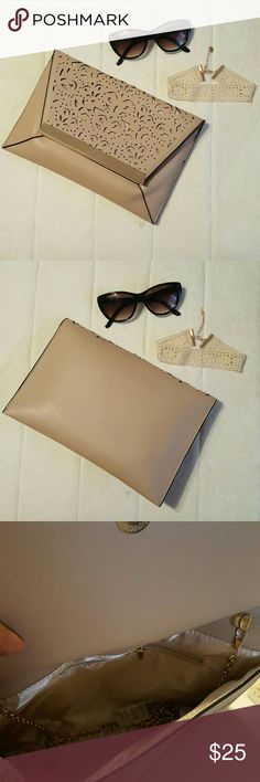 WEEKEND SALE Laser-cut Nude Clutch New with tag laser-cut nude clutch. Bags Clutches & Wristlets