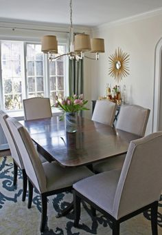 Duncan Phyfe style table with more modern furnishings.