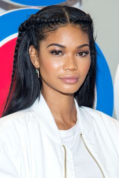 Chanel Iman parted her hair in the middle and did a French overhanded braid on…