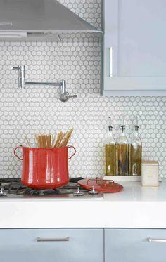 penny tile backsplash /  Blue Kitchen Cabinets / terra cotta properties