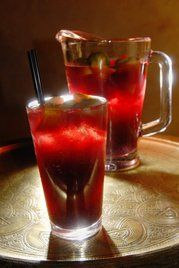 blood red sangria Ingredients 1 bottle (inexpensive) red wine 12 oz club soda 2 oz cognac 3 tbs warmed honey 4 sliced figs ½ cup red or black grapes, halved ½ cup pitted cherries (can use frozen if necessary) Ice