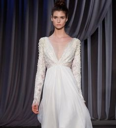 Winter wedding dress inspiration | V-neck with long sleeves gown by Christian Siriano