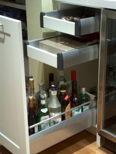 In the absence of a (basement) bar area, this is a great liquor storage idea.