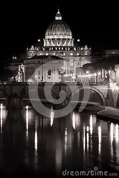 Scene of Saint Peter (Vatican) and the river Tiber at the night. With reflections on the water. Soft colors, almost black and white. Location: Rome, Italy