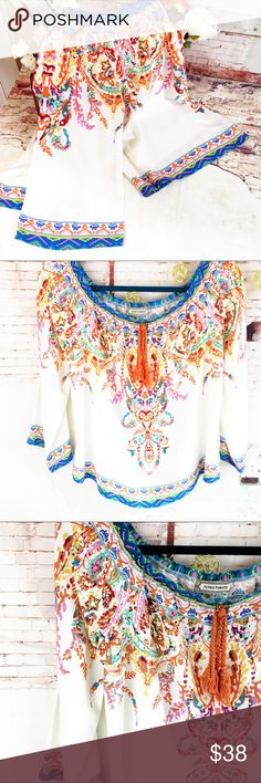 "FLYING TOMATO BOHO TOP Size Small FLYING TOMATO BOHO TOP SZ S, But could fit Medium Pre owned, gently worn and in very good condition. No rips or stains. Smoke free home. Great colors! Believe it's Rayon. Have washed and hung to dry. SZ small. Top flat side to side in stretched 17"" top to bottom front 18 1/2"" back 17"" sleeve from armpit: 13"" Wear off shoulders or up. Elastic top Flying Tomato Tops"