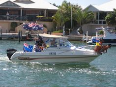 Mandurah Australia Day celebrations start with a big Aussie Breakfast on Mandurah Foreshore and finish with a boat Flotilla through the canals and estuary – seen here from our jetty at Port Sails Canal Villa
