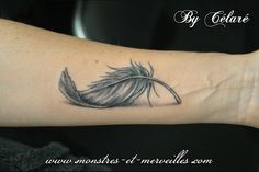 I like this small feather..i would put the empty ❤ in center.