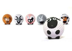 Aniballs - golf balls with four feet and a face in the shape of a cow, sheep, donkey, pig, goat, and dog. #creative #golf #ball