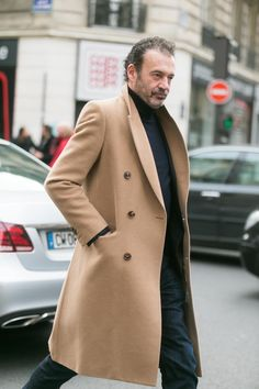 slim-cut camel coat is one of the sharpest items a man can have in his wardrobe