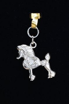 Sterling Silver Poodle Charm by Donna Pizarro from her Animal Whimsey Collection of Fine Dog Jewelry and Poodle Jewelry