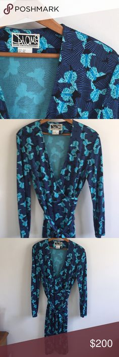 DVF vintage silk wrap dress butterfly print 100% silk wrap dress by Diane Von Furstenberg. Beautiful blue and black butterfly pattern.  Size 10.  Pit to pit 19 Length from shoulder 41 Sleeve length 23 Dry clean only.  Great vintage condition. One small area has some fraying as pictured. Small flaw in fabric pattern printing also pictured. Some writing on tag as pictured.  To gorgeous to be hanging in my closet, make an offer! Let me know if you have any questions and thanks for looking…