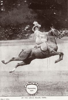 This picture shows what an equestrienne, a female horse rider, had to cope with in 1910. Not only did she have to perform all the leaps and tricks of a horseback act, but had to do it fully corseted and riding side-saddle.   The Cirque Molier was an amateur circus set up by Ernest Molier in his home in Paris in 1880, which continued until his death in 1934.