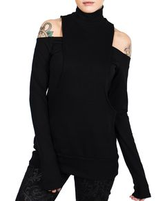 Long sleeve top featuring zip up overlay with roll neck. Model wears size M