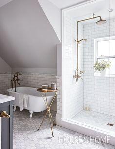 Designer Allison Wilson's third-floor bathroom has a charming look thanks to a restored vintage bathtub and traditional antiqued-brass fixtures. | Photographer: Angus Fergusson #tilebathtub