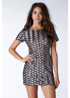 Well Blended Mini Sequin Dress || A modest mini dress featuring an all sequin exterior. Sequins are layed out in a triangle design with different colored sequins. The colors blend together well, creating a shimmery finish. Subtle yet chic, this dress has a crew neck neckline and short sleeves. Lined on the inside for comfort, this dress has a single zipper on back for closure.