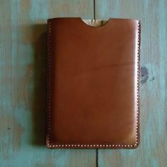 A simple slip case/sleeve for your ipad mini. Handmade of golden brown english bridle leather and waxed white linen thread. This cover is sewn by hand and will last forever! Handmade and built to last in Texas! $70