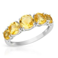 Ring With 5 Genuine    Citrines - Size 8    Size 8. Ring well made in 925 sterling silver with nice citrines. Total item weight 2.3g. Gemstone info: 4 citrines, 1.50ctw., with round shape and yellow color. 1 citrine, 0.85ctw. with round shape and yellow color.