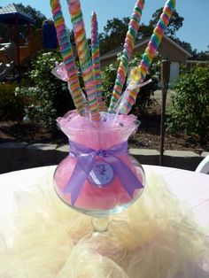 I like tulle in the center under some flowers for  a babyshower