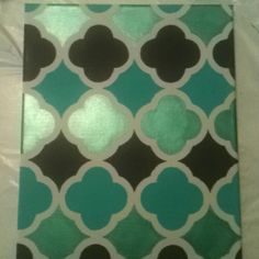 I made this using a template from another pin (the pattern is quatrefoil). I first painted the whole canvas grey and I used a metallic emerald green, turquoise and purple paint to fill in.