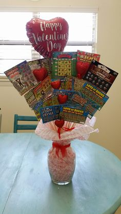 Made this lottery ticket bouquet for my husband for Valentine's Day this year! Works great for any occassion! Supplies -Lottery tickets -Skewer sticks (walmart) -green foam (Dollar Tree) -vase (Dollar tree) -glitter hearts (walmart) -tissue paper -misc decor pieces Pretty self explanatory, just wanted to share what I used and where I found them. Have fun making it for your special ocassion!