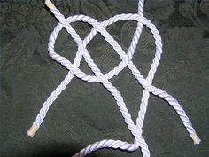 Left hand rope threaded through loop on right hand rope