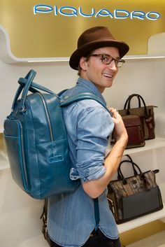 Oliver Proudlock with Piquadro Blue Square backpack