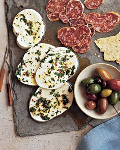 "Marinated Mozzarella (recipe) - ""Serve with olives, crackers, bread, and cured meats."""