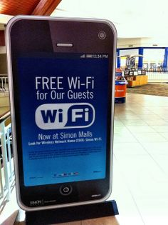 Make your Stuff Obvious - David Lee King - BIG free wifi sign in the shape of a smartphone found at local shopping mall.