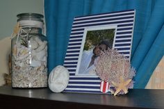 Shell jar coral and sand dollar. Beachy Picture Frame. Rustic simple decor. Beach style. Nautical style. Coastal living. Cleat.