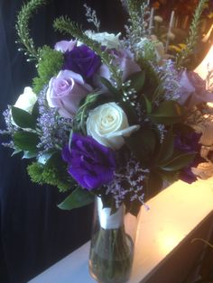 White Veronica, Playa Blanca and Sterling Silver roses, Green Trichelium, Purple Lisianthus hand tied bridal. Silver Roses, Veronica, Wedding Designs, Sterling Silver, Bridal, Purple, Green, Bride, Brides