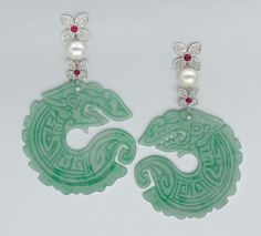 Carved jade, cultured pearl and diamond earrings. So unusual and pretty.