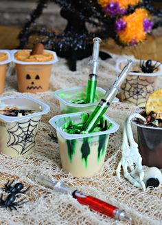 Halloween party snacks: Toxic Waste Pudding Cups. Easy to make with food coloring and toy syringes. #MixInMonsterMash #ad