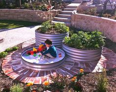 This container garden design includes a versatile lower container that makes a great sandbox for kids! via Lushome