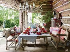 A porch at Ralph Lauren's Colorado ranch is furnished with Mexican sabino-wood pieces, including a table made from a salvaged door and ox yokes; the tableware and linens are by Ralph Lauren Home. Rustic Outdoor Spaces, Outdoor Rooms, Outdoor Dining, Patio Dining, Outdoor Seating, Dining Table, Architectural Digest, New York Homes, New Homes