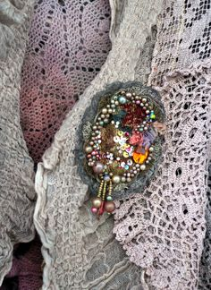 Romantic brooch with rich hand beading is made of salvaged antique tapestry piece and named after french tapestry manufacture of the 17th and 18th